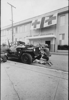 Humanitarian G.I. Firefight where G.I. pushes little kid under jeep for protection, Santo Domingo, May 5. 1965